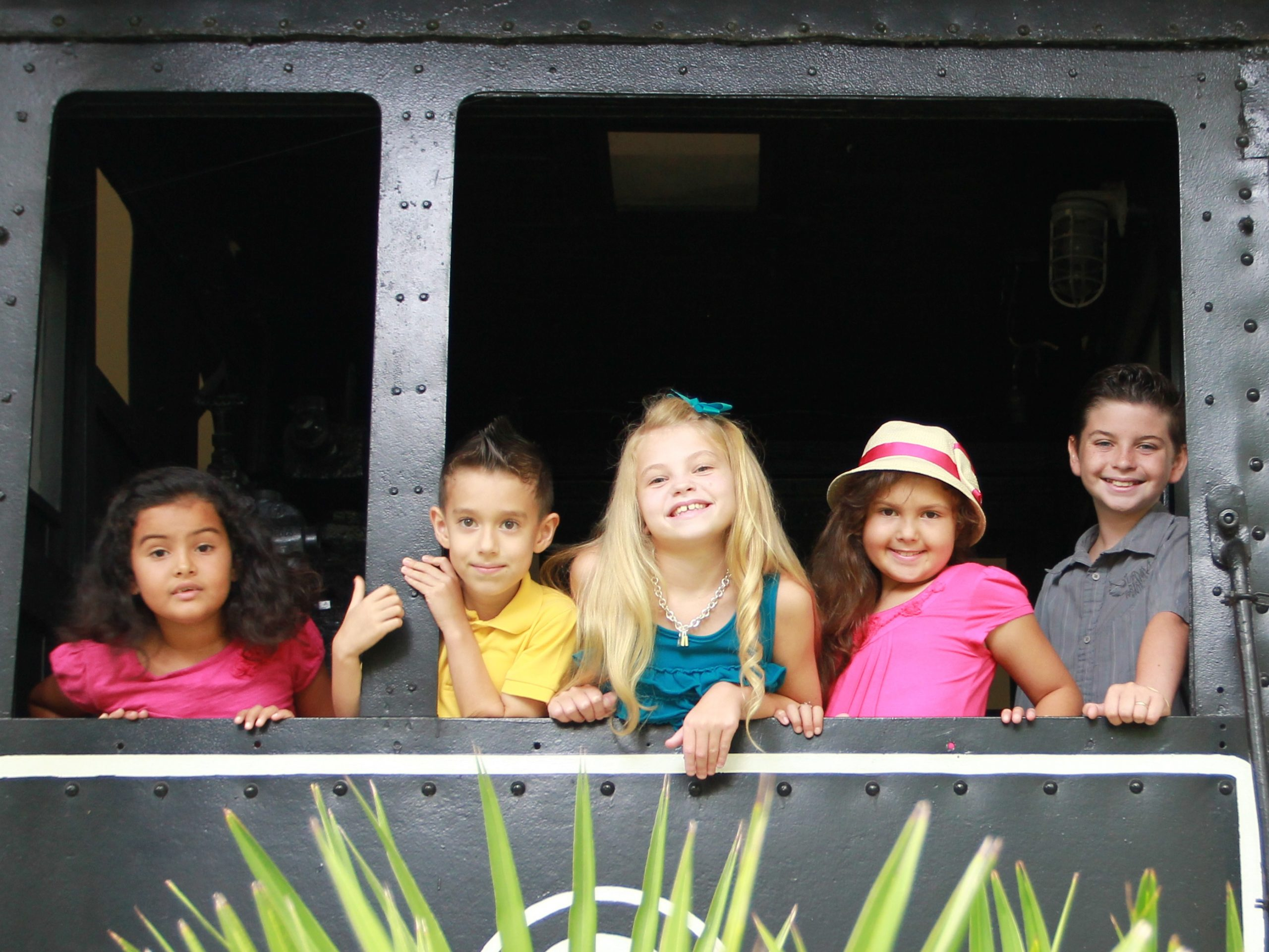 Children smiling out of locomotive window