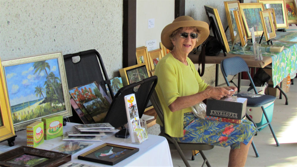 Artist displaying paintings
