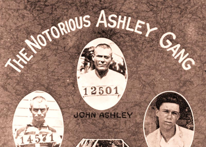 Scrapbook page labeled The Notorious Ashley Gang with mug shots of 3 men