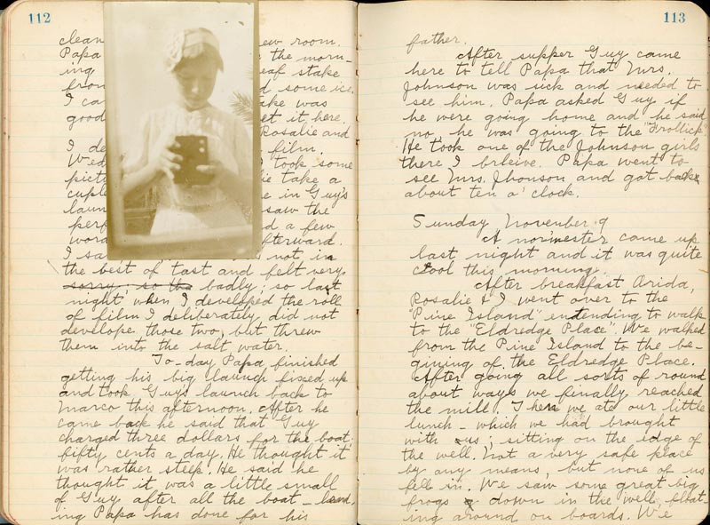 Photo of a handwritten diary with a picture of a young girl