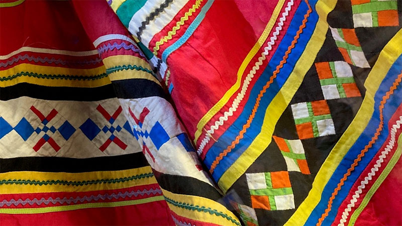 close-up photos of patchwork skirt with red blue yellow green white and orange cloth