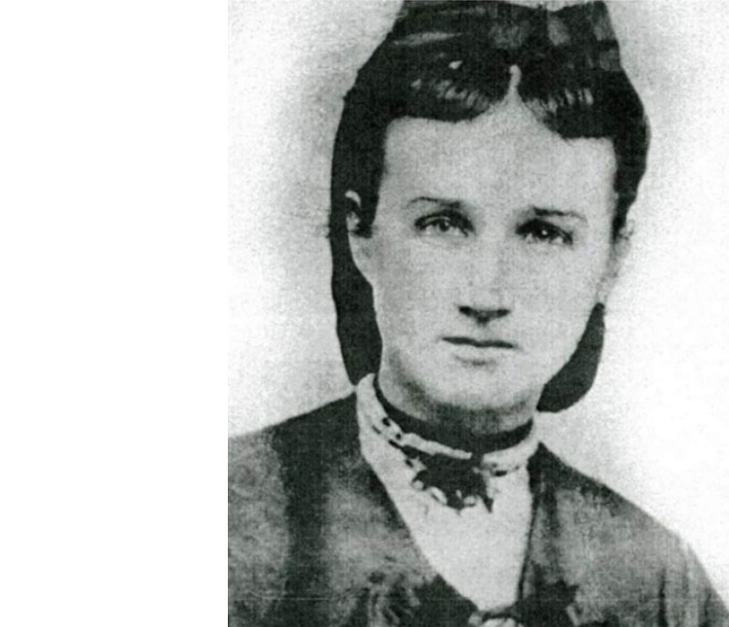 Photo of Mary Brickell in her high collared shirt and small hat.