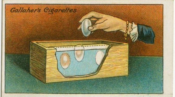 Drawing of a hand dropping an egg into a box