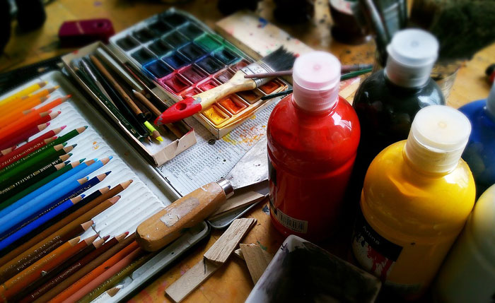 Photo of paints, pencils, and other artist tools
