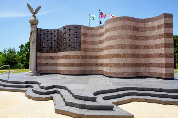 Photo of the Collier County Freedom Memorial with a large sculpture of an American Flag